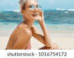 attractive female model wears... | Shutterstock . vector #1016754172
