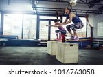 fitness woman doing box jump... | Shutterstock . vector #1016763058