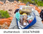 Small photo of Hikers pack with food items in the dunes near the Indian Ocean seen from the Oyster Catcher Trail near Mosselbay on the Garden Route in South Africa popular with tourists