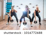 group of three young sporty... | Shutterstock . vector #1016772688