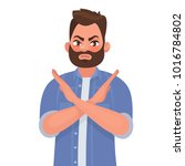 man shows a gesture no or stop. ... | Shutterstock .eps vector #1016784802