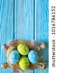 painted easter eggs in the nest ... | Shutterstock . vector #1016786152