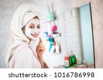 young woman looks after the...   Shutterstock . vector #1016786998