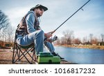 fisherman angling on the river. ... | Shutterstock . vector #1016817232