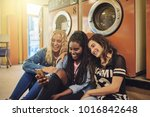 group of young female friends... | Shutterstock . vector #1016842648