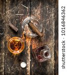 french cognac with a cigar. on... | Shutterstock . vector #1016846362