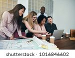 diverse group of designers... | Shutterstock . vector #1016846602