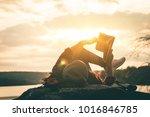 women tourists read books in... | Shutterstock . vector #1016846785
