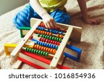 hand of little boy playing with ... | Shutterstock . vector #1016854936