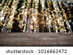 empty wooden table in front of...   Shutterstock . vector #1016862472