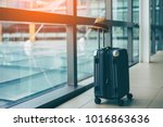 suitcases with hipster hat in... | Shutterstock . vector #1016863636