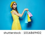 young beautiful woman on blue...   Shutterstock . vector #1016869402