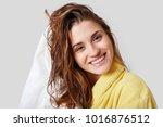 lovely female with wet hair ...   Shutterstock . vector #1016876512