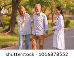 elderly family health care... | Shutterstock . vector #1016878552