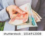 russian rubles in the hands of... | Shutterstock . vector #1016912008