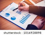 businesswoman analyzing... | Shutterstock . vector #1016928898