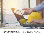 architect engineer using laptop ... | Shutterstock . vector #1016937148