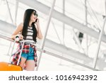 cute young asian traveler woman ... | Shutterstock . vector #1016942392