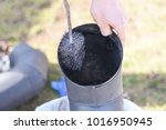man cleaning chimney pipe... | Shutterstock . vector #1016950945