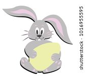 easter bunny with dyed egg | Shutterstock .eps vector #1016955595