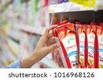 woman hand choosing to buy... | Shutterstock . vector #1016968126