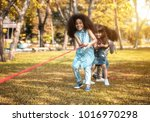 children are happy to play tug... | Shutterstock . vector #1016970298