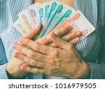 business woman presses russian... | Shutterstock . vector #1016979505