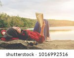 relaxing moments  young woman... | Shutterstock . vector #1016992516