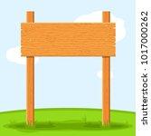 wooden signboard in grass... | Shutterstock .eps vector #1017000262