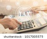 women using calculator... | Shutterstock . vector #1017005575