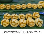 freshly cut mango for sale at a ...   Shutterstock . vector #1017027976