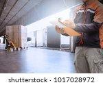 warehouse worker hand holding... | Shutterstock . vector #1017028972