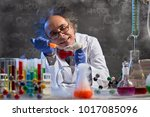 Small photo of crazy chemistry professor injecting lab mouse for his wacky experiment