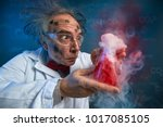 Small photo of wacky scientist with explosive experiment, funny chemist