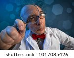 Scientist in a white coat doing ...