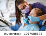 dentist repairing child's tooth ... | Shutterstock . vector #1017088876