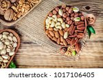 nuts mixed in wooden bowls. to... | Shutterstock . vector #1017106405