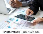 business team meeting working... | Shutterstock . vector #1017124438