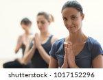 women practicing yoga and... | Shutterstock . vector #1017152296