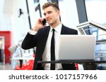 young adult businessman using... | Shutterstock . vector #1017157966