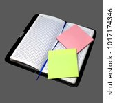 Small photo of Notebook.Trade.Address book.Text. Notes.Multicolored stickers.Isolated background.