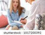 female psychologyst therapy... | Shutterstock . vector #1017200392