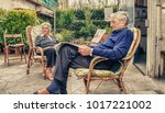 retired mature couple relaxing... | Shutterstock . vector #1017221002