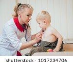 doctor woman examining...   Shutterstock . vector #1017234706