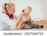 doctor examines ear with... | Shutterstock . vector #1017234715