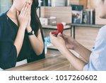 asian man showing an engagement ... | Shutterstock . vector #1017260602