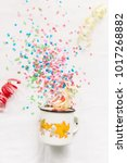Small photo of White mug with confetti isolate festive mocap.