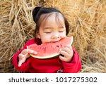 kid eating watermelon happiness | Shutterstock . vector #1017275302