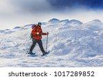 male adventurer in winter... | Shutterstock . vector #1017289852