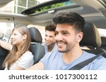 group of happy friends on a car | Shutterstock . vector #1017300112